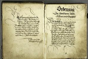 Doppelseite aus einem alten handschriftlichen Zunftbuch von 1476 bis 1581 © Stadtarchiv Mainz, 21/290